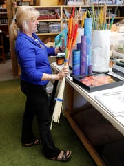 Bev Taylor holds some of the colored cattails she uses