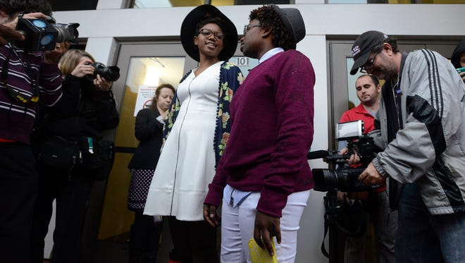Tori Sisson, left, and Shante Wolfe wait at the door to get their marriage license at the Montgomery County Probate Office in Montgomery, Ala. on Monday February 9, 2015. There were at least 545 same-sex couples who married during the three weeks that gay marriage was allowed in Alabama.