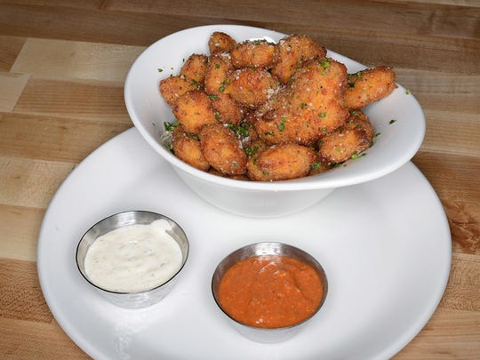 Parmesan-breaded cheese curds with romesco and buttermilk