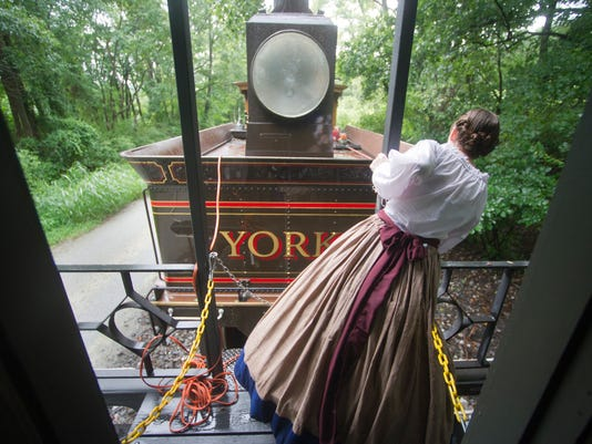 Theresa Strange signals to the operators of the locomotive during the Reading Express. YORK DAILY RECORD/SUNDAY NEWS - PAUL KUEHNEL