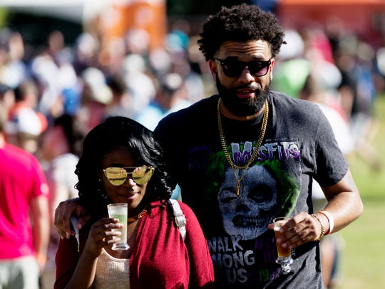 Latifah Caldwell and Wayne Mance of Rock Hill, S.C., attend the 21st annual Knoxville Brewers' Jam at World's Fair Park on Oct. 7, 2017.
