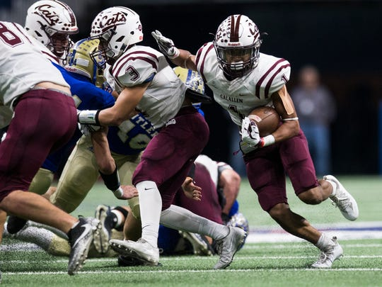 Calallen's Zach Hawkins rushes the ball against Kerrville Tivy during their Class 5A Division II regional semifinal game Saturday, Dec. 2, 2017, at the Alamodome in San Antonio.