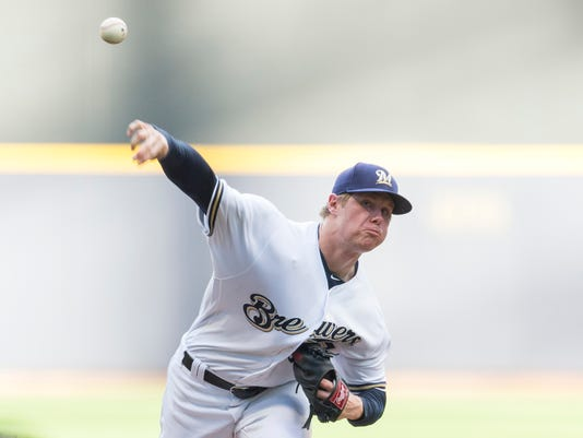 Milwaukee Brewers' Chase Anderson pitches to an Arizona Diamondbacks batter during the first inning of a baseball game Monday, July 25, 2016, in Milwaukee. (AP Photo/Tom Lynn)