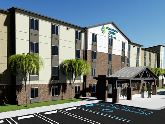 A rendering of WoodSpring Suites extended-stay hotel
