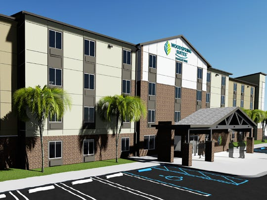 A rendering of WoodSpring Suites extended-stay hotel planned to be built this year on U.S. 41 East in East Naples