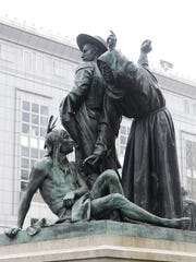 This Friday, March 2, 2018 photo shows a statue of a Native American, bottom, with Sir Francis Drake, top left, and Father Junipero Serra in San Francisco. San Francisco's arts commission is considering removing a statue that some say is degrading to Native Americans.