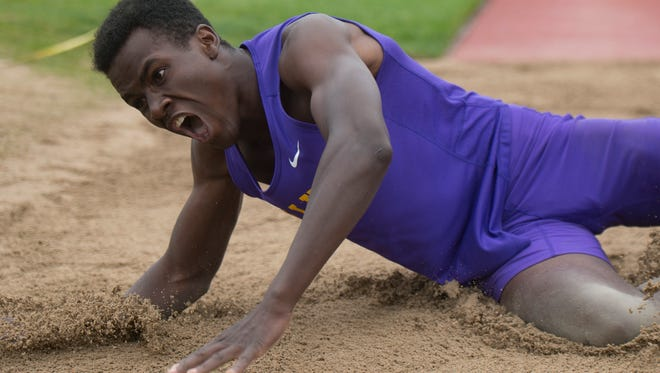 Allam Bushara of Fort Collins hits the sand pit during a state title winning flight in the triple jump competition during the CHSAA State Track and Field Championships at JeffCo Stadium in Lakewood on Saturday, May 19, 2018.