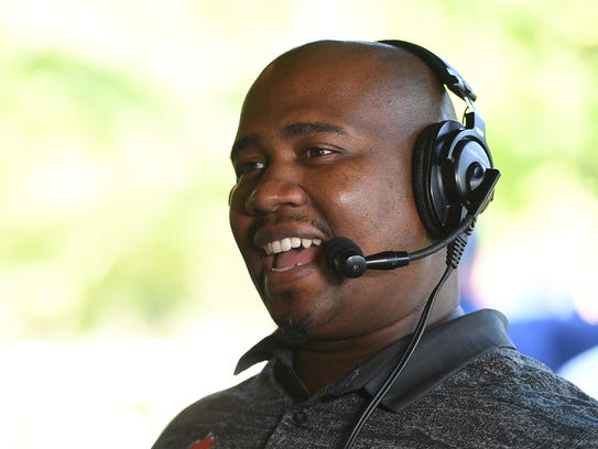 Clemson defensive line coach Todd Bates does a radio