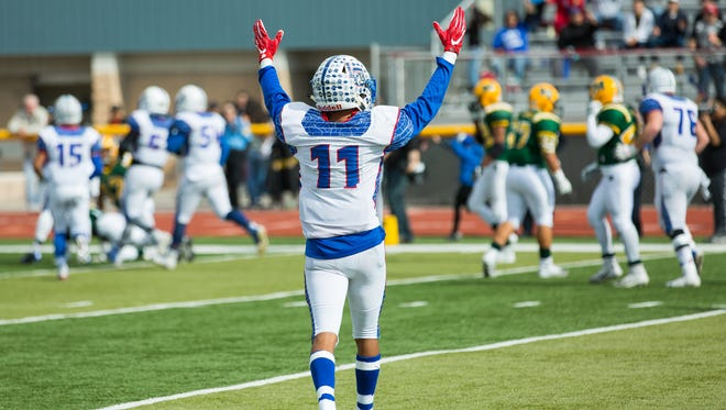 Las Cruces High School's Ivan Molina indicated a LCHS touchdown on Saturday, November 5, 2016, during the Cruces Mayfield game at The Field of Dreams.
