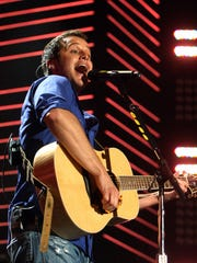 Easton Corbin performs for the crowd at the 2010 CMA Music Festival in Nashville, TN.