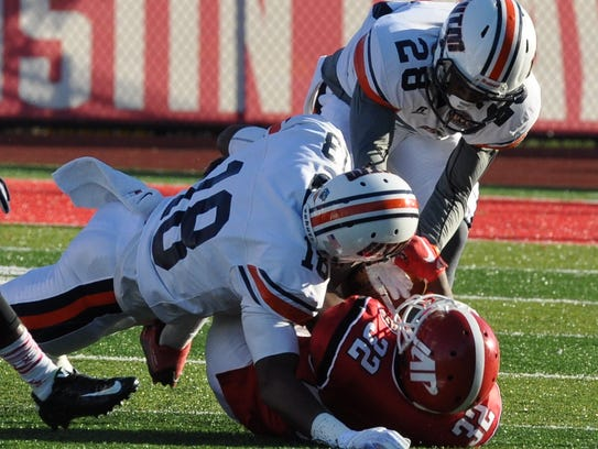 Julian Franklin is tackled by two UT Martin defenders