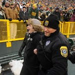Green Bay Police escort a man from the field on Jan. 1, 2012 after he ran onto the playing surface and was tackled by Green Bay Packers linebacker Brad Jones.