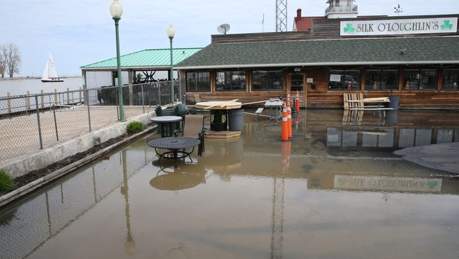 Waters from the rising Lake Ontario flood the parking lot, closing Silk O'Loughlin's Restaurant at 5980 St. Paul Blvd. in Irondequoit.