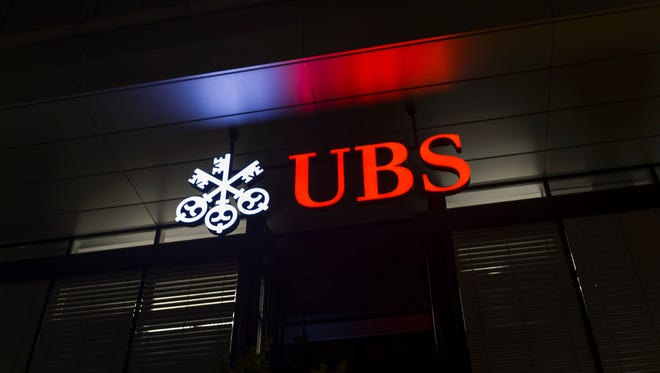 A picture taken on Feb. 25, 2016 shows the logo of the Swiss global financial services company UBS at the entrance of a branch's building in Zurich.