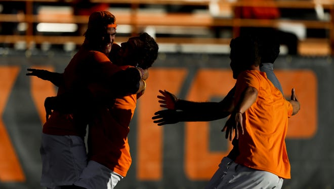 Tennessee celebrates a 4-2 win over Kentucky Thursday in the SEC tennis tournament.