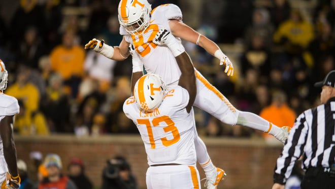 Tennessee offensive lineman Trey Smith (73) lifts Tennessee tight end Ethan Wolf (82) in the air after he made a touchdown during a game between Tennessee and Missouri at Faurot Field in Columbia, Missouri, on Saturday November 11, 2017.