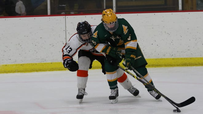D.C. Everest senior defenseman J.J. Berdal, right, made a verbal commitment to the Colorado College men's hockey program last week. Berdal was a first-team all-Wisconsin Valley Conference and honorable mention all-state pick last season.