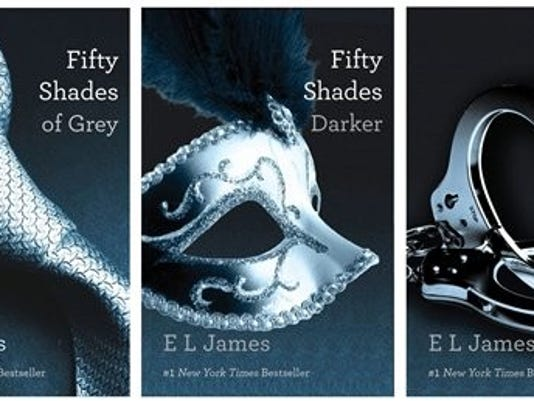 This file combo made of book cover images provided by Vintage Books shows the 'Fifty Shades of Grey' trilogy by best-selling author E L James. (AP Photo/Vintage Books)