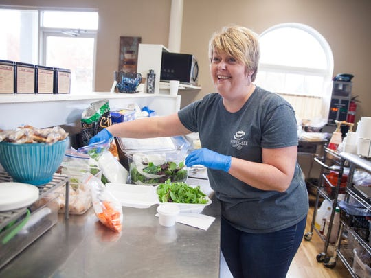 Nikki Sprouse, co-owner of Nisa's Cafe in Verona, makes a salad while talking to one of her customers on Wednesday, Oct. 29, 2015.