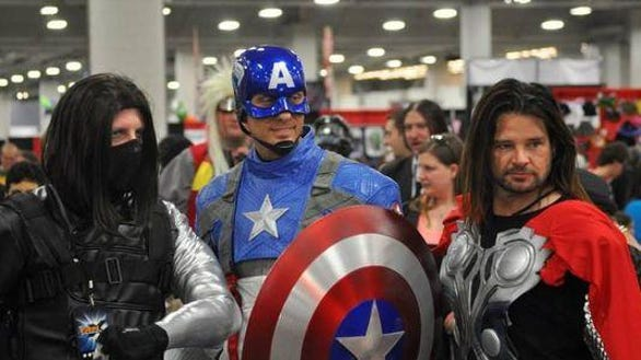 Cosplayers pose for a photo at FanXperience in 2014.