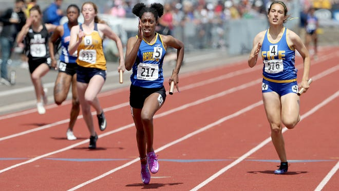 Bremerton's Tyishea McWhorter heads toward the finish line Saturday to help the Knights' girls 4x100-meter relay team win a Class 2A title at the state track and field championships at Mount Tahoma High School.
