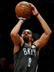 Brooklyn Nets guard Spencer Dinwiddie shoots against the Orlando Magic during the second half of an NBA basketball game Wednesday, Jan. 23, 2019, in New York. The Nets defeated the Magic 114-110. (AP Photo/Adam Hunger)