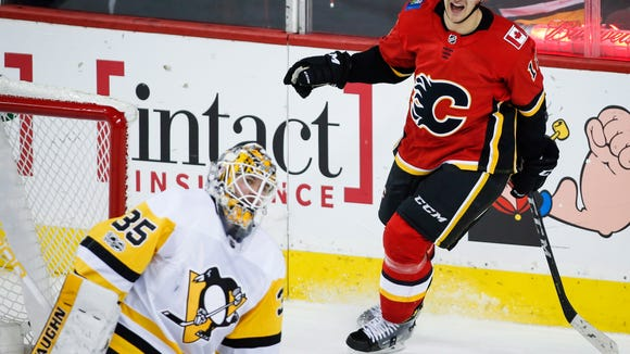 Pittsburgh Penguins goalie Tristan Jarry, left, looks