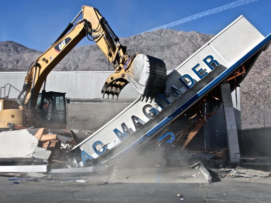 Lucas Esposito/The Desert Sun After being abandoned for about a decade, the Mac Magruder Chevrolet building in Palm Springs was demolished in November 2015. The building had become a dangerous magnet for the homeless.