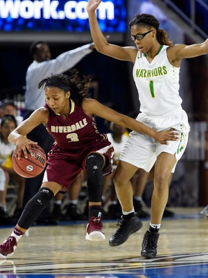 Anastasia Hayes (3), of Riverdale High School, left, battles against Jireh Washington (1), of Memphis Central High School during the first half of the Tennessee Division I AAA girls' high school basketball championship game Saturday, March 11, 2017, in Nashville.