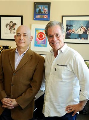 Jack Sussman, left, executive vice president of specials, music and live events for CBS Entertainment, and Hollywood Film Awards executive producer R.A. Clark pose together in Sussman's office at CBS Studio Center in Los Angeles. The Hollywood Film Awards, which have been presented off-camera since 1997, will make their TV debut Friday as a two-hour special on CBS.