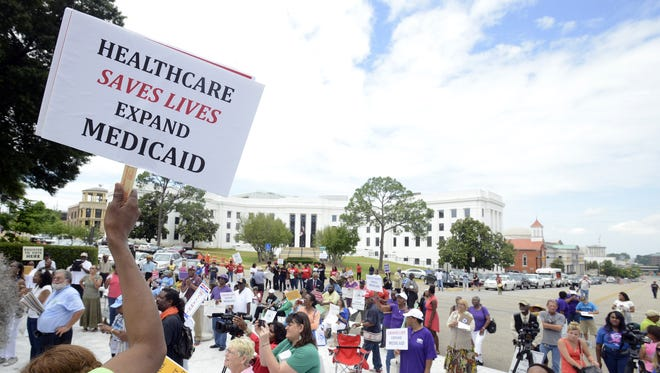 Mary Moncrease (left) attends a rally held by the Save OurSelves Movement on Saturday, May 31, 2014, at the Capitol. The organizations called for Medicaid expansion.