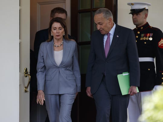 Speaker of the House Nancy Pelosi of Calif., and Senate Minority Leader Sen. Chuck Schumer of N.Y., walk out of the White House after meeting with President Donald Trump about infrastructure, Tuesday, April 30, 2019, in Washington.