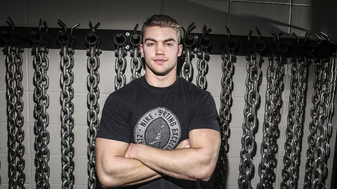 Iowa recruit Ryan Boyle poses inside the Dowling weight room in late January. He'll immediately become one of the strongest quarterbacks in Hawkeye history.