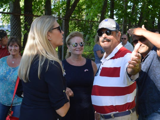 Putnam County Executive MaryEllen Odell, center, with
