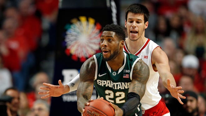 Wisconsin's Duje Dukan defends Michigan State's Branden Dawson in the first half  of the Big Ten tournament title game in Chicago, Sunday, March 15, 2015.