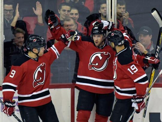 The Devils' uniforms.