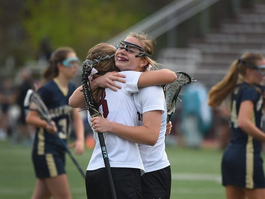 Lillie Kloak (no.22) of Ridgewood is hugged by teammate Hannah Cermack (no.18) after her goal  in a game against Oak Knoll in 2016.
