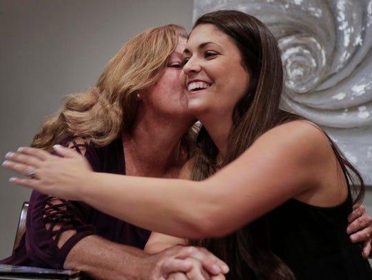 Shana Muse, left, kisses her daughter, Rachael Bryant,