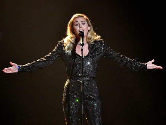 Musician Miley Cyrus performs onstage during MusiCares