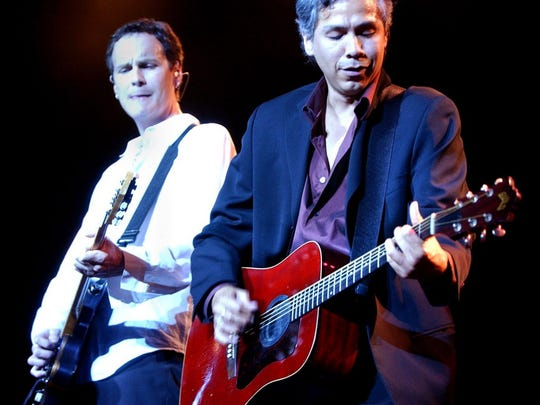 Sam Llanas (right) and Kurt Neumann of the BoDeans perform July 1, 2002, at the Marcus Amphitheater.
