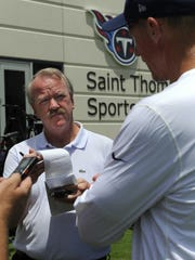 Columnist David Climer talks with Titans coach Ken Whisenhunt after a practice in this file photo. Climer, whose award-winning career at The Tennessean spanned more than 40 years, died Sunday.