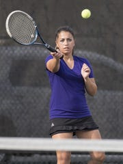 Mission Oak's Taylor Costa returns to Tulare Union's Jaci Maze in the No.1 girls singles match. Costa won the match 6-0, 7-5.