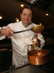 Bernard Dervieux, chef-owner of Cuistot in Palm Desert, prepares Bourgeoise sauce.