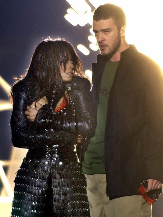 "FILE - In this Feb. 1, 2004, file photo, singer Janet Jackson covers her breast as Justin Timberlake holds part of her costume after her outfit came undone during the halftime show of Super Bowl XXXVIII in Houston. The NFL announced Sunday, Oct. 22, 2017, that Timberlake will headline the Super Bowl halftime show Feb. 4 in Minnesota, 14 years after the ""wardrobe malfunction"" with Janet Jackson cause a national controversy. (AP Photo/Elise Amendola, File)"