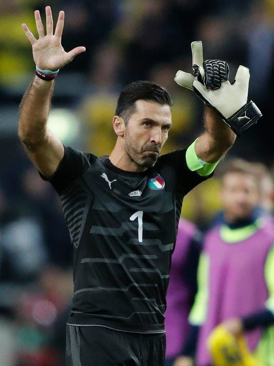 FILE - In this Friday, Nov. 10, 2017 file photo, Italy goalkeeper Gianluigi Buffon waves to fans at the end of the World Cup qualifying play-off first leg soccer match between Sweden and Italy, at the Friends Arena in Stockholm, Friday, Nov. 10, 2017. Gianluigi Buffon's international career might not be done after all. Interim Italy coach Luigi Di Biagio believes he has convinced the 40-year-old goalkeeper to stay on for friendlies against Argentina and England next month. (AP Photo/Frank Augstein, File)