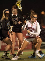 Susquehannock's Kenna Hancock, right, was named the Attacker of the Year recently by the York-Adams League Girls' Lacrosse Coaches Association. Hancock posted 86 points on 63 goals and 23 assists while helping the Warriors go through Y-A play undefeated at 12-0. Susquehannock is 15-2 overall. YORK DISPATCH FILE PHOTO
