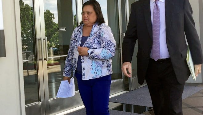 Lerma Aquino, left, leaves the District Court of Guam after her arraignment on July 25, 2017.