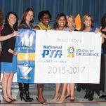 Brentwood Elementary has been designated a National PTA School of Excellence. Principal Lisa Arnold, from left, Vera Wiley, Brittany Jones, Nikki Hughes, Deidre Young, Leticia Dennis, Alison Brantley, Diane Freyhofer, Della Pettit and Escambia County Schools Superintendent Malcolm Thomas display the National PTA School of Excellence banner during a ceremony on Wednesday.