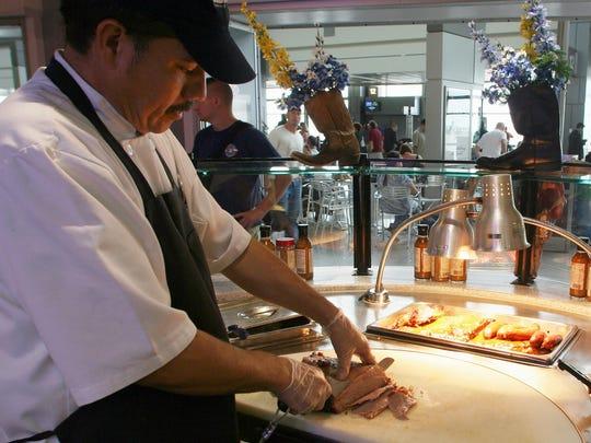 Francisco Tonche cuts meat at post-security Salt Lick