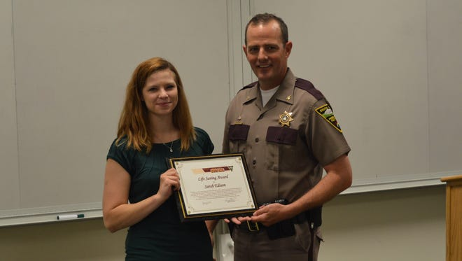 Sarah Edison receives her award from Col. Craig Price